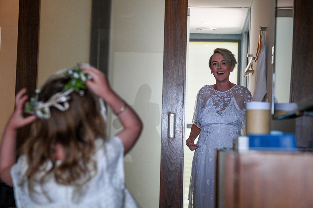 Bride emerges in a maxi lace bareback wedding dress by ASOS