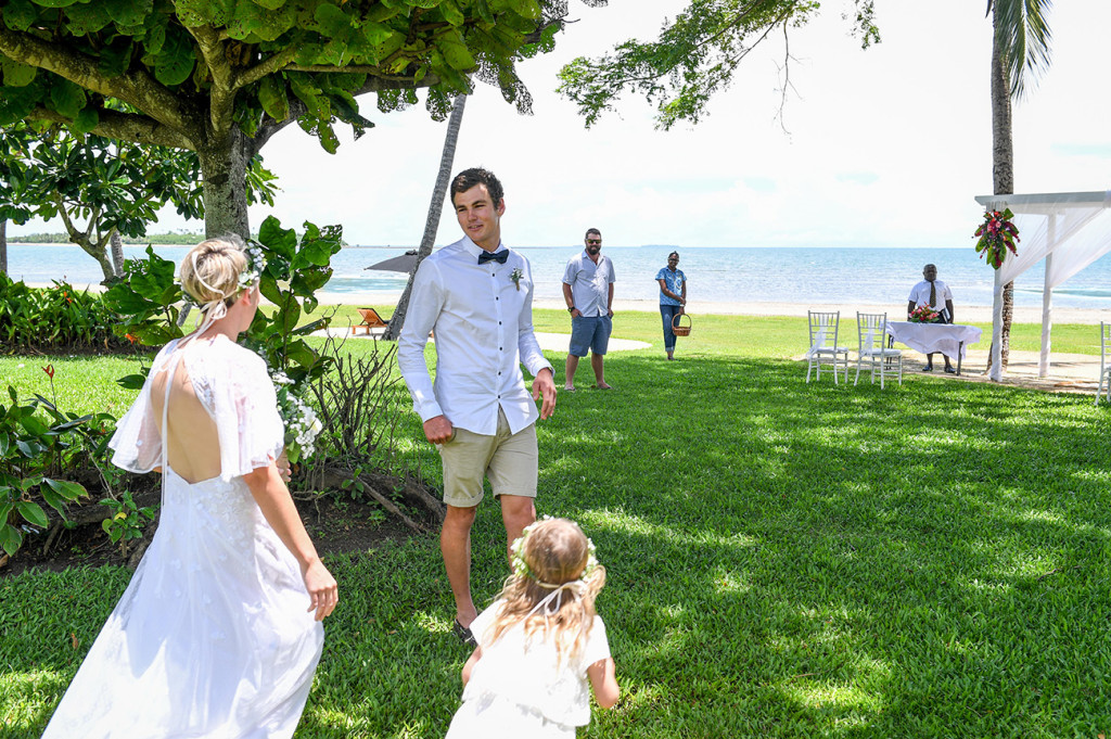 Groom greets his bride and daughter at their wedding in Hilton Denarau Fiji