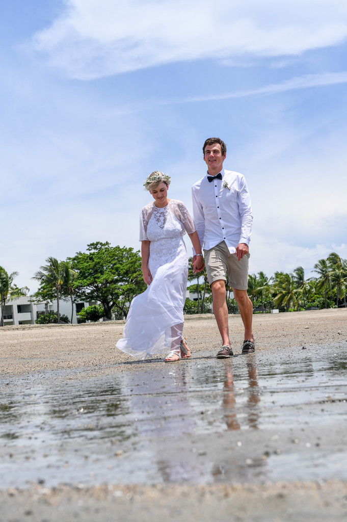 Newly married couple walk hand in hand after elopement at the Deanarau Fiji