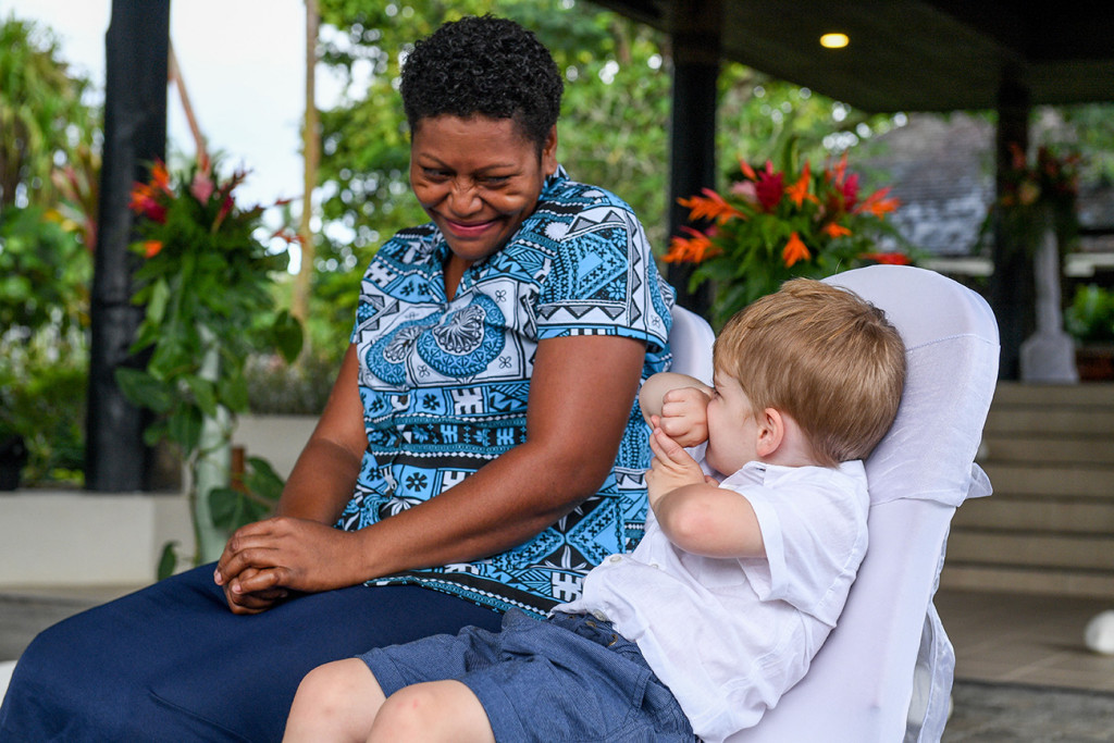 Best boy and nanny play at ceremony
