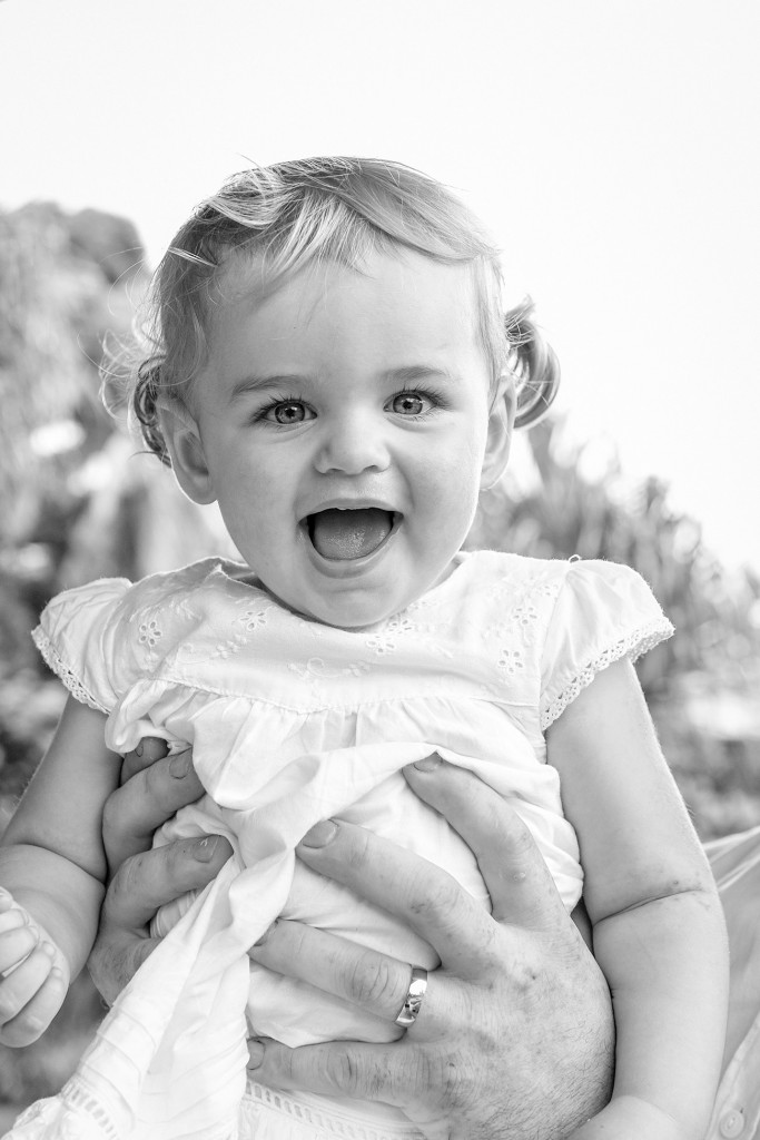 Monochrome photo of cute smiling flower girl