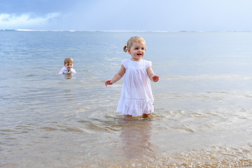 Cute baby girl playing in the sea