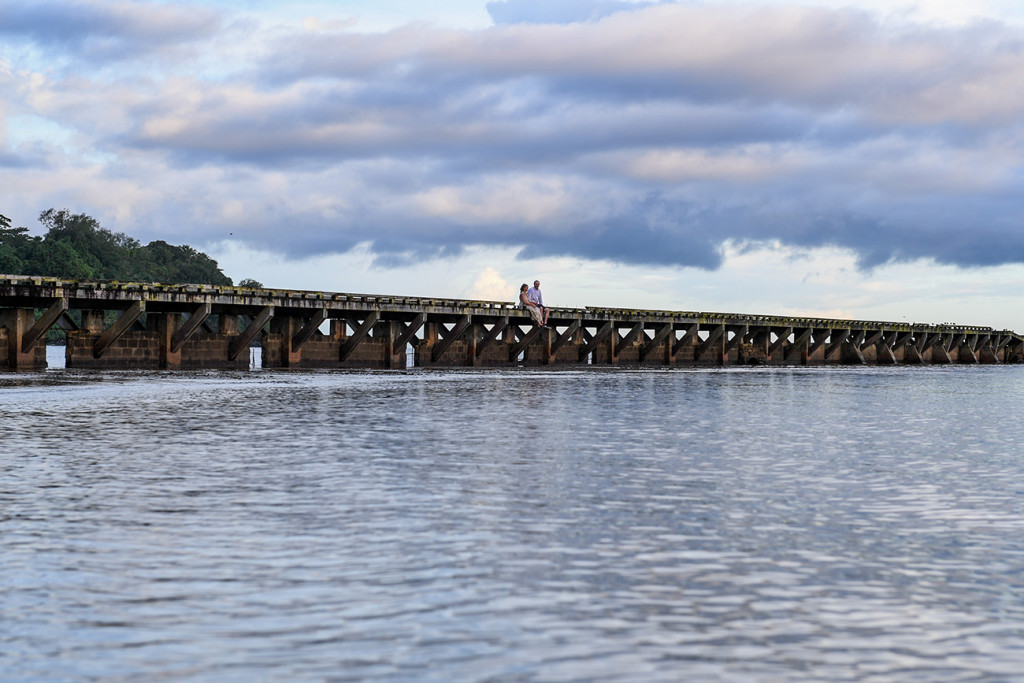 Landscape photo of married couple on a bridge against clouds in Naviti Fiji