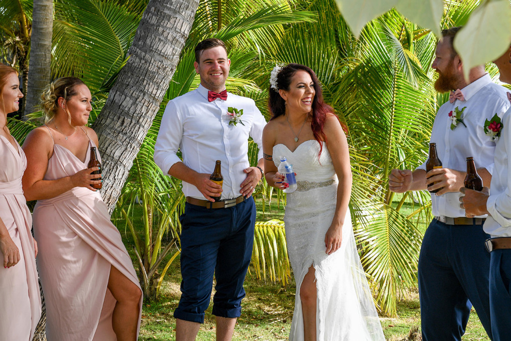 Bridal party enjoys a cheeky beer right after the ceremony