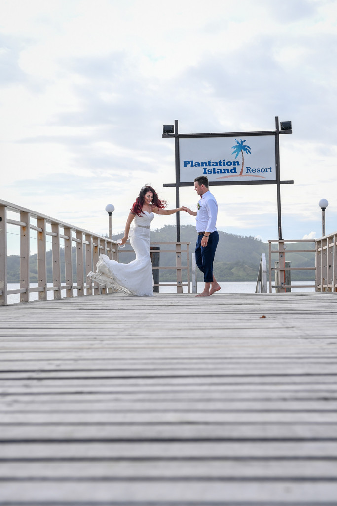 The bride dances on the dock with her husband at the Plantation Island Resort