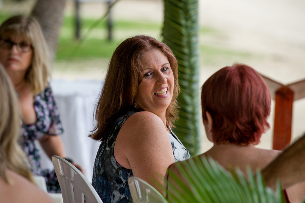 A smiling wedding guest