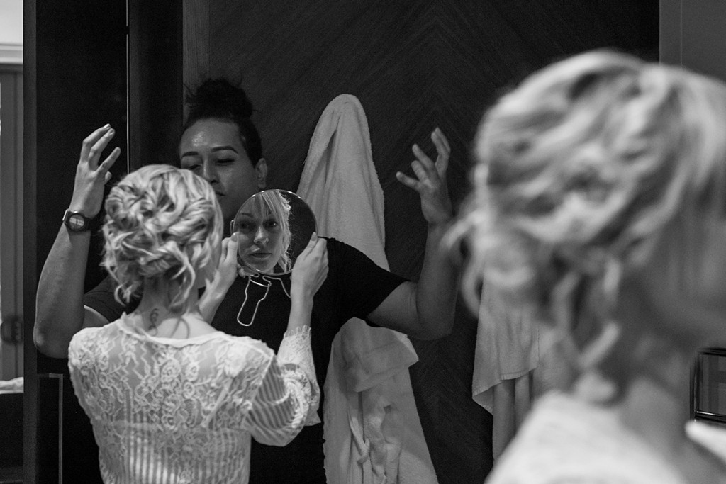 Monochrome reflection of bride in concave mirror at the Intercontinental Fiji