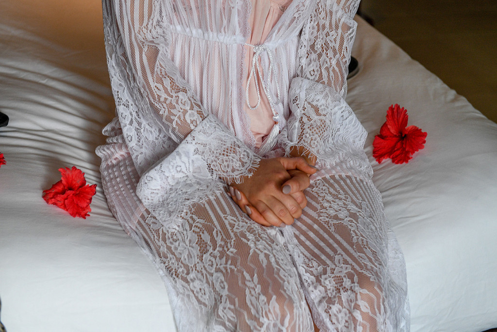 Pre wedding jitters: Nervous bride in bohemian lace gown
