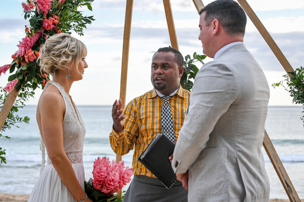 Passionate celebrant marries the eloping couple by the beach