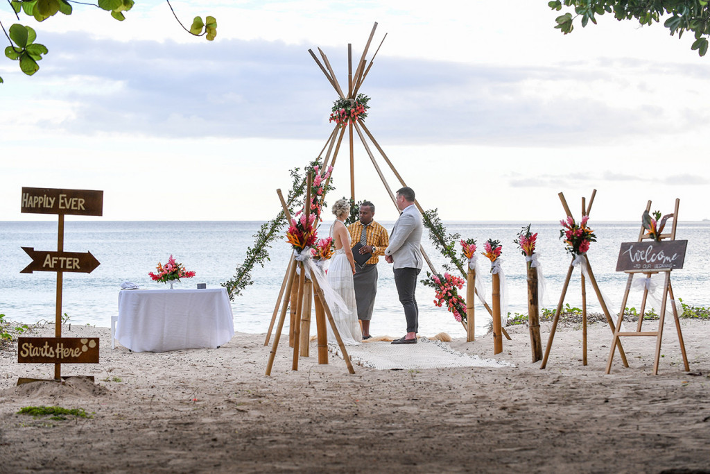 The Wedding teepee decorated by ginger flowers as an altar overlooking the pacific at the Fiji Coral coast