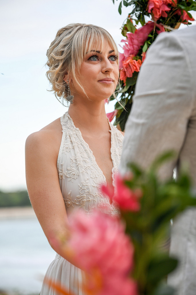 Stunning blue eyed bride stares lovingly into her groom's eyes