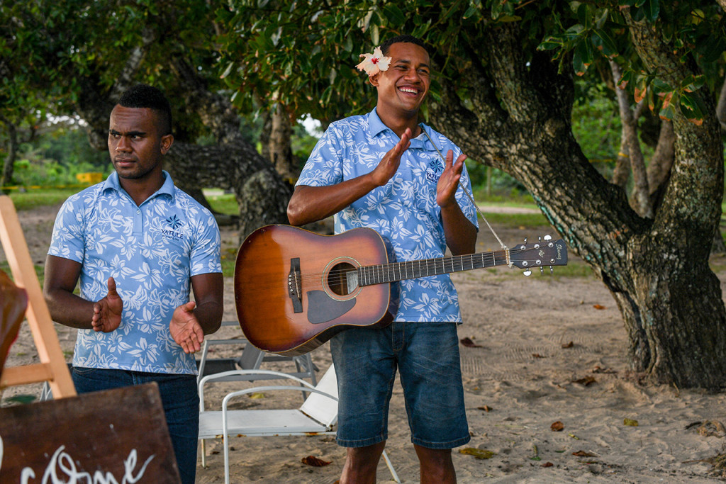 A happy guitarist of the Paradise Bride team in Fiji celebrates the newly weds
