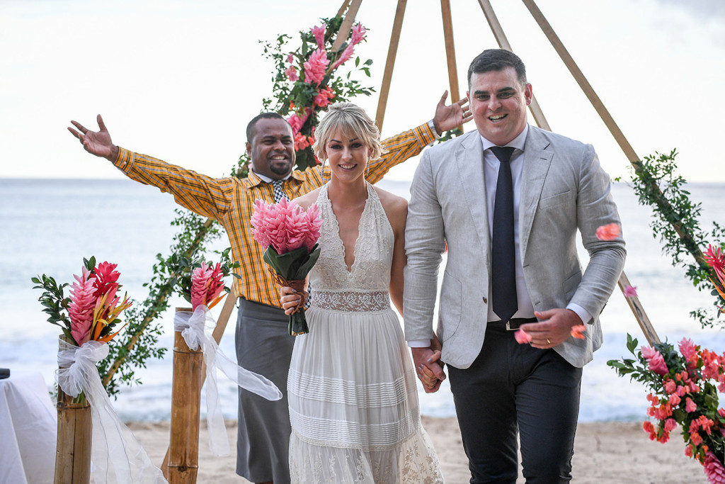 Finally married: The celebrant celebrates the newly weds as they walk down their boho style aisle