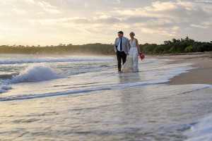 Couple stroll on beach
