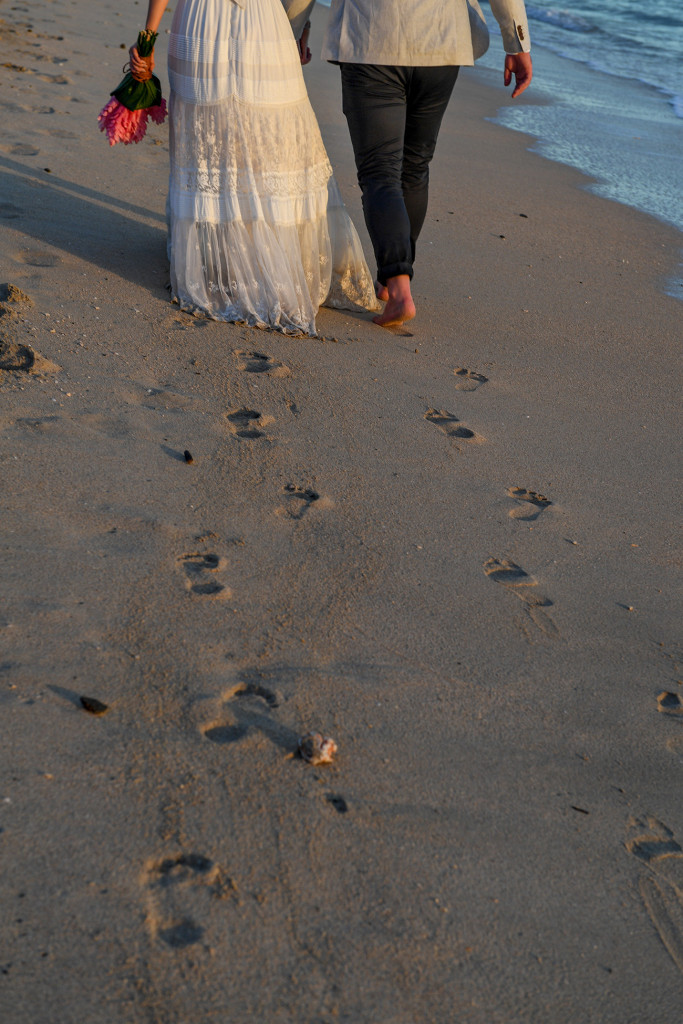Bride and groom leave footprint in the sand at Yatule Resort Fiji