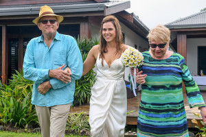 Stunning bride walking down the aisle with her parents