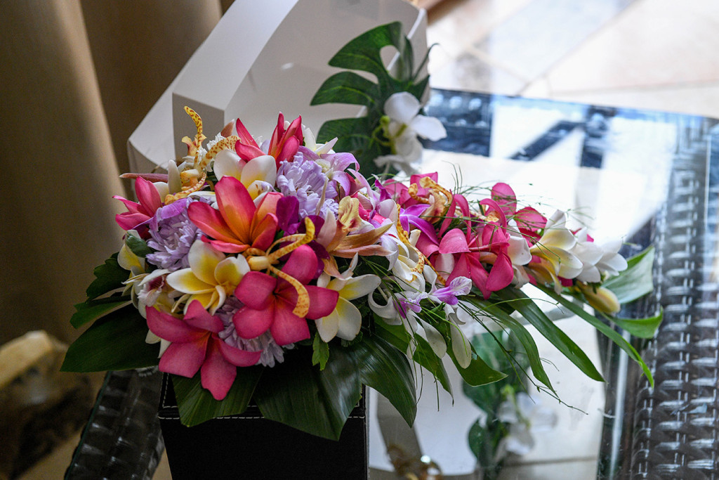 A bouquet made of an assortment of Fiji orchids, frangipani and hibiscus