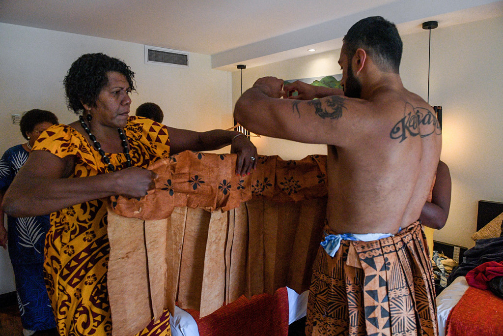 The groom is helped into this Samoan Masi