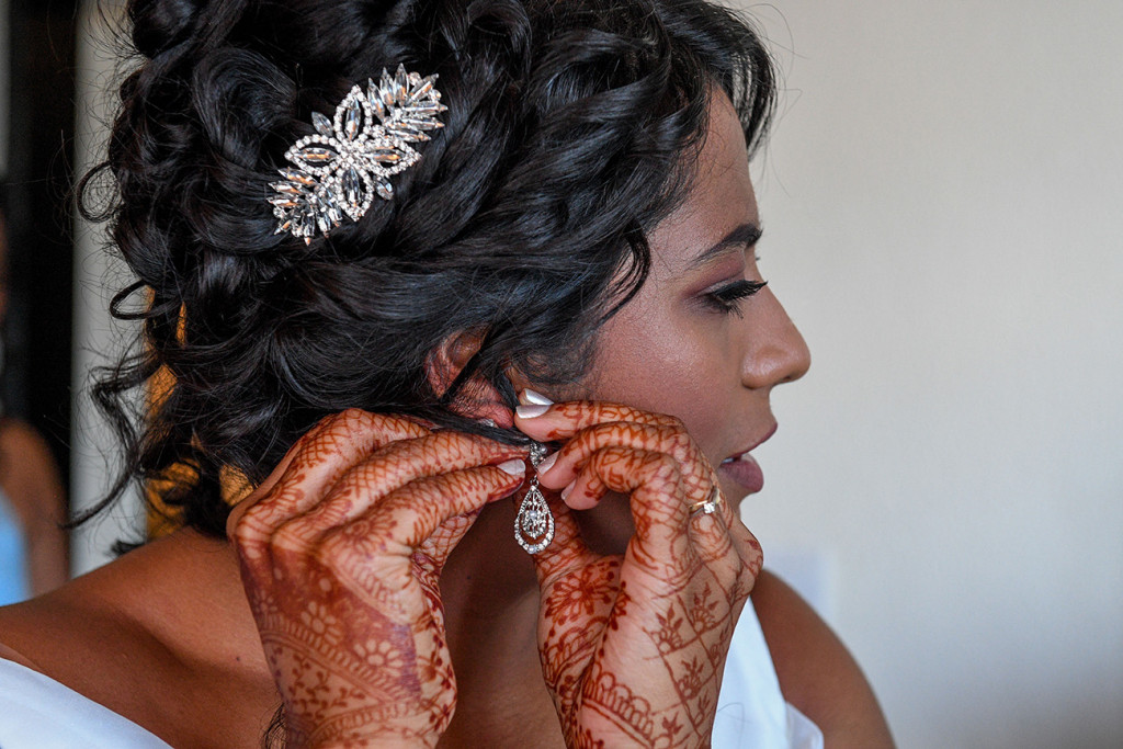A closeup of the bride's hennaed hands wearing her wedding jewellery