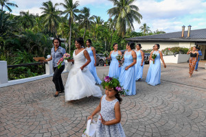 Bride and her bridesmaids dance to the wedding venue