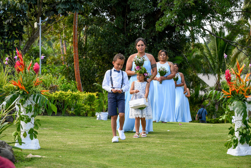 Flowergirl, page boy and bridesmaids lead the way down the aisle