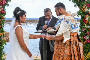 Groom places ring on bride
