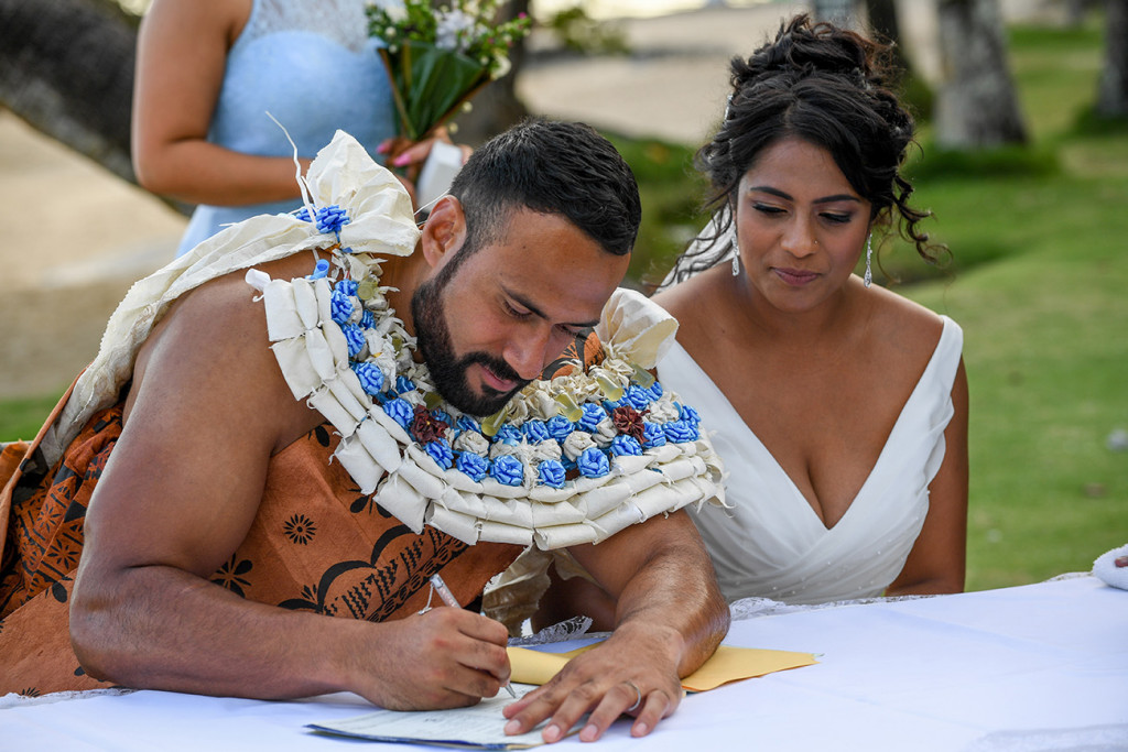 The groom signs the marriage certificate
