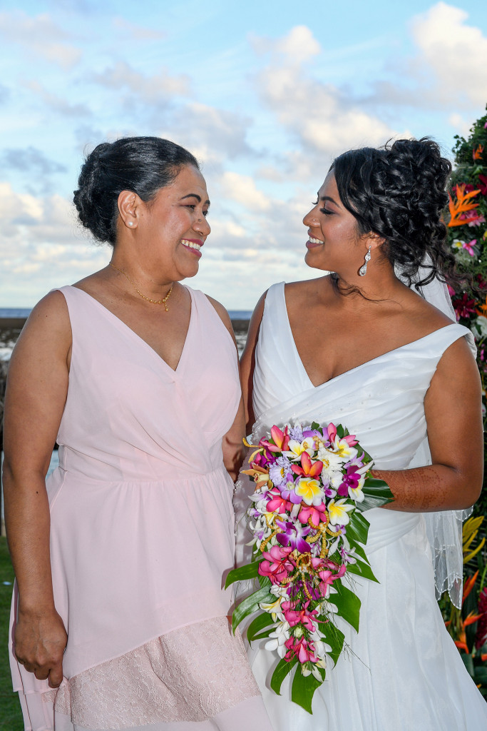 The bride smiles with her mother