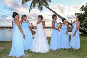 The bride and her bridesmaids laugh in the moment