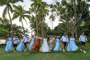 Bridal party hold hands as they do a running man photoshoot