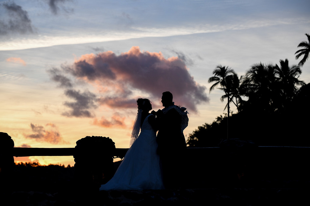 A silhouette of the couple's pinky swear in Fiji sunset