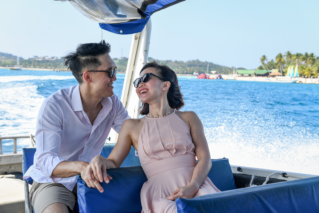 The couple gaze lovingly into each other's eyes while on cruis
