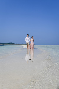 Couple strolling in water