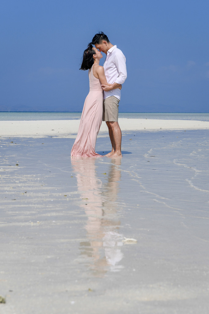 The lovebirds lovingly gaze into each other's eyes at the shores of the reef at Malolo Lai Lai Island Fiji