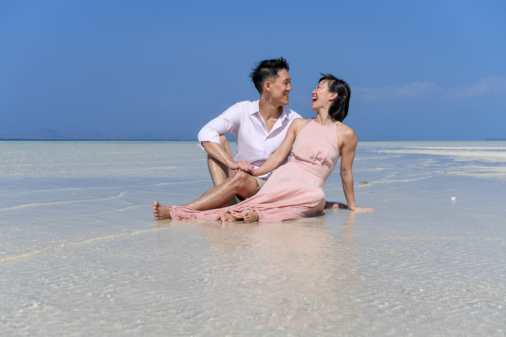 The couple laugh when seated in the shallow waters at Malolo Lai Island