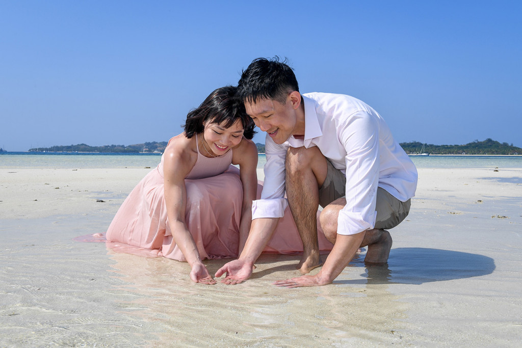 The couple collects shells in the shallow waters of the reef at Malolo Lai Lai Island