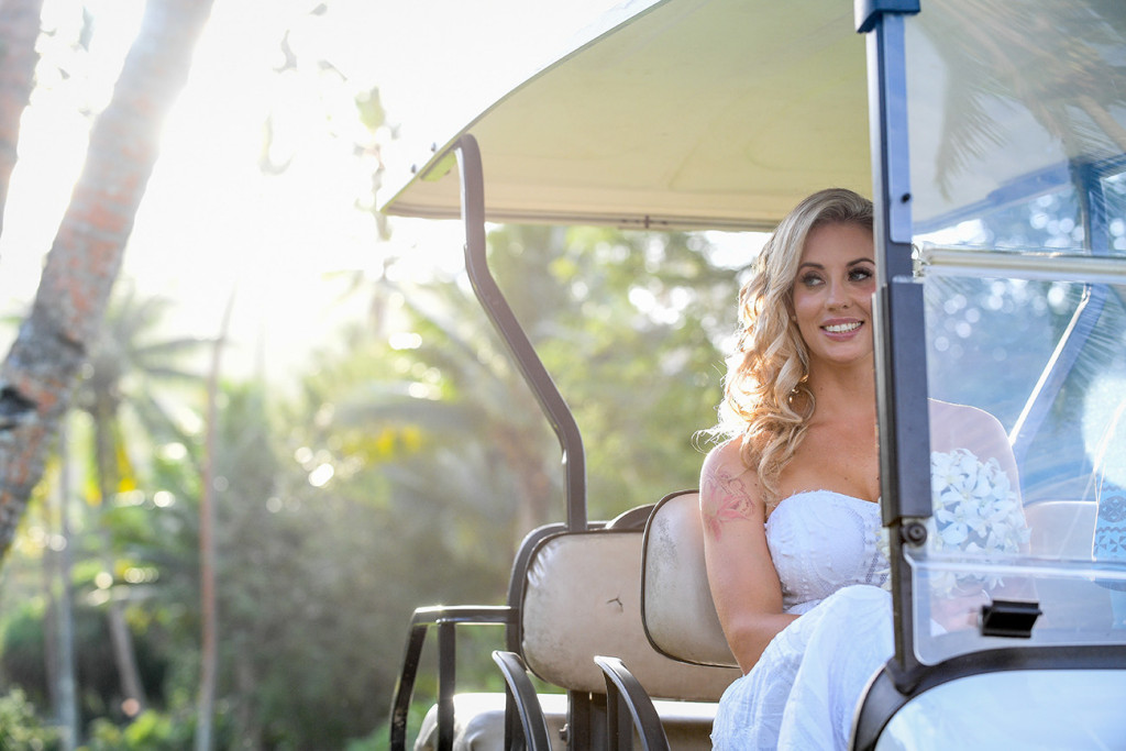The glowing bride arrives in a golf cart