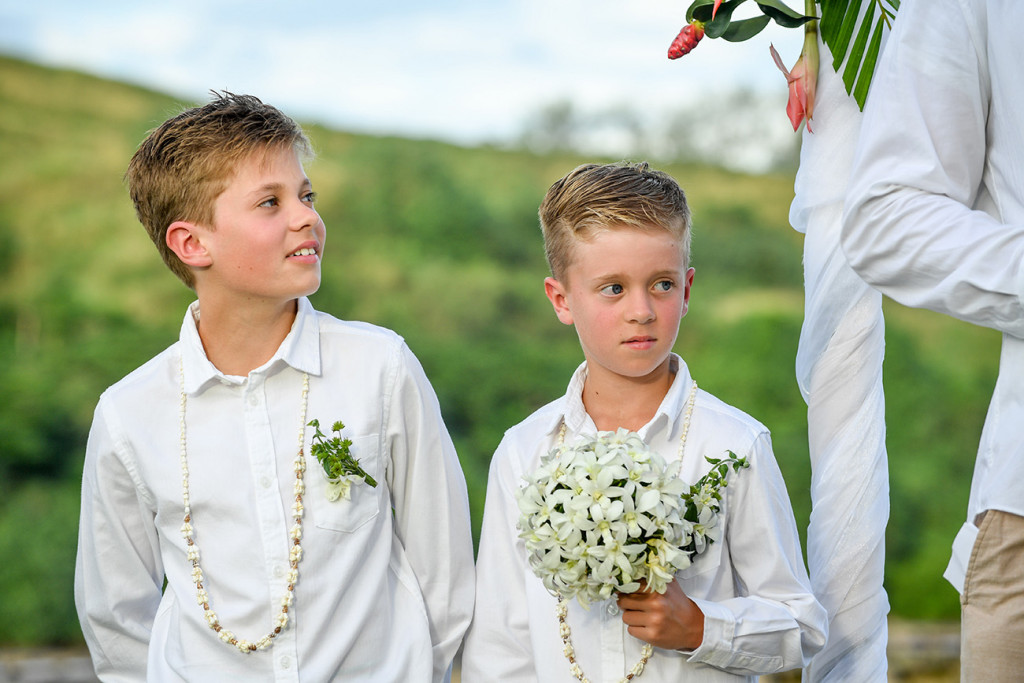 The best boys watch their parents marry at the palm tree altar