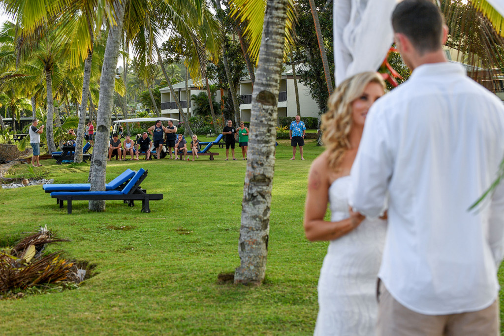 Hotel goers watch the wedding ceremony from far