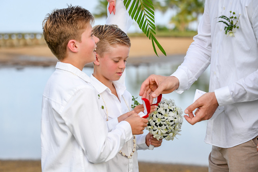 the best boys hand the groom the rings