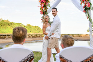 Bride and groom smile at sons