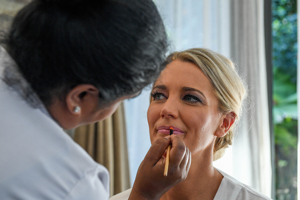 Closeup of the bride's make up being done by Intercontinental Hotel