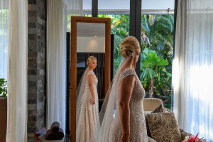 Bride admires dress in the mirror