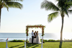 Picture perfect portrait of the couple saying vows against the Pacific ocean