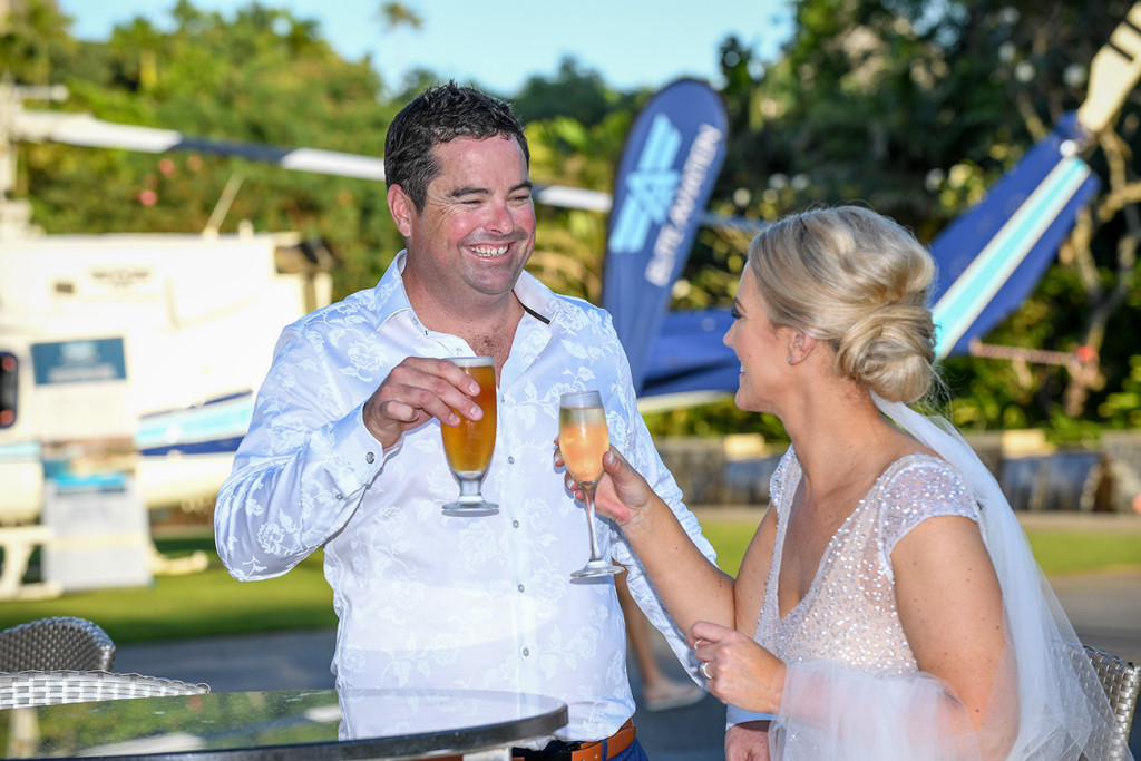 The happily married couple share a cheeky drink after their ceremony