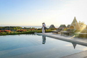 Breathtaking kiss at the edge of the pool against the glorious Pacific