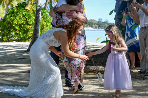 Bride playing with flowergirl