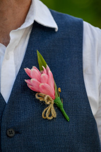 Pink tropical flower boutonniere