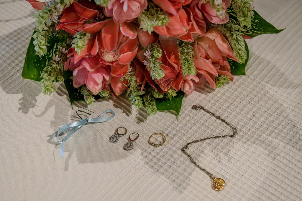 Gold Wedding band and jewellery by Monaco jewellers beside ginger bouquet at Musket Cove
