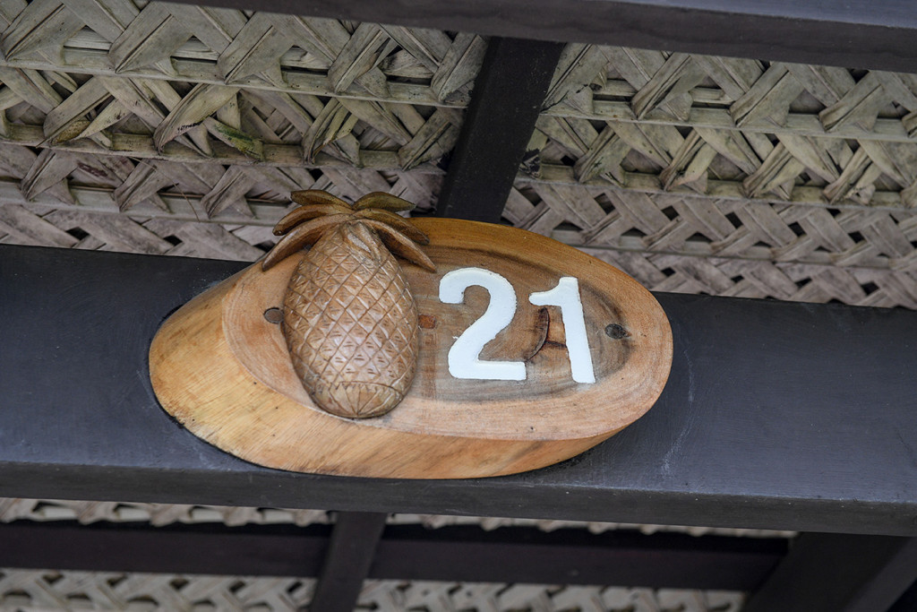 Wooden curved pineapple on Musket Cove room key